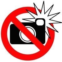 Thumb no flash photography sign