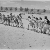 Thumb girls at isleta day school in a tug of war  albuquerque  new mexico  1940   nara   519167